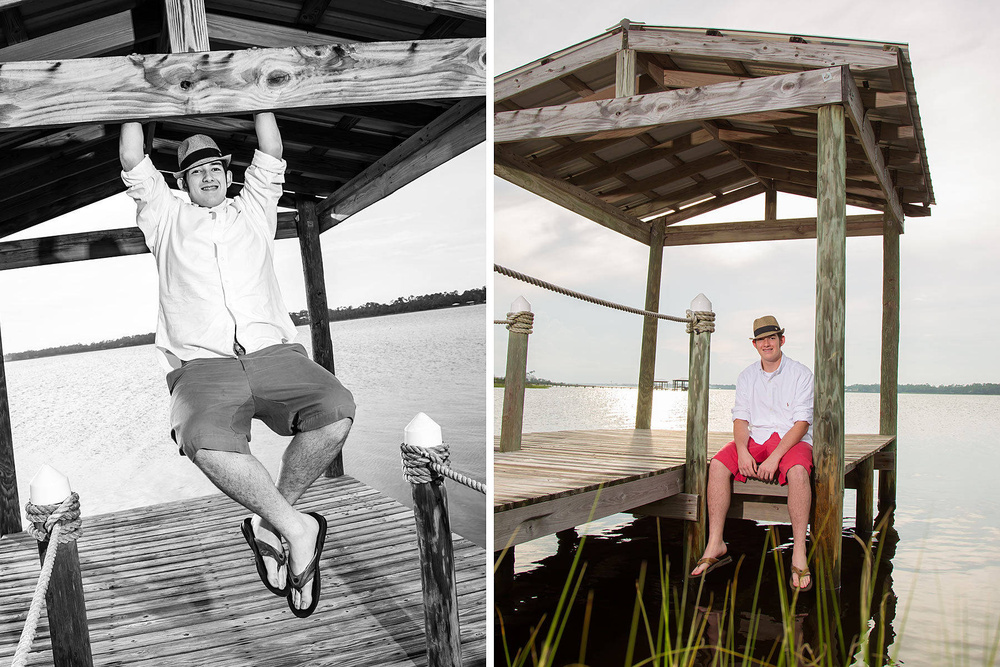 Male subject on pier wearing hat for senior portrait